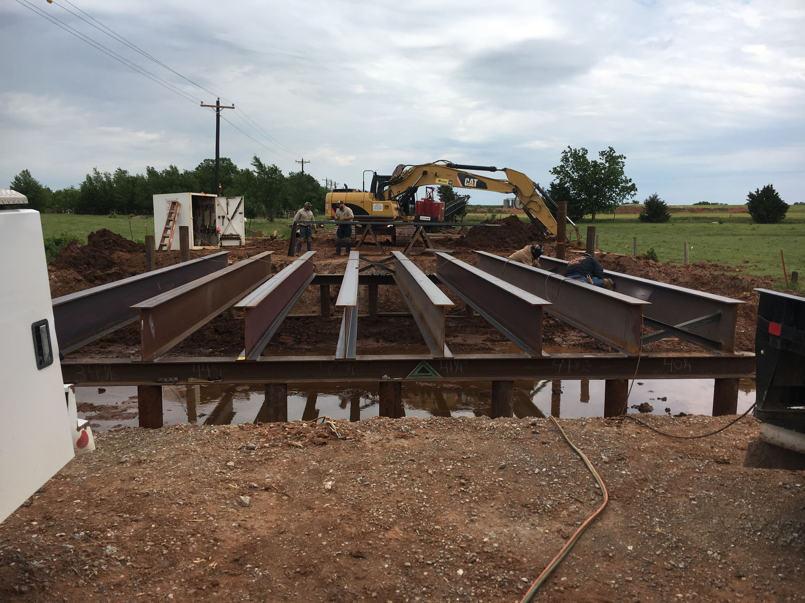 District 2 workers welding beams on a new bridge