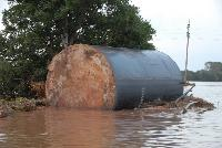 oil storage tank floating in floodwaters