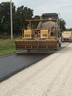 Machine doing road work